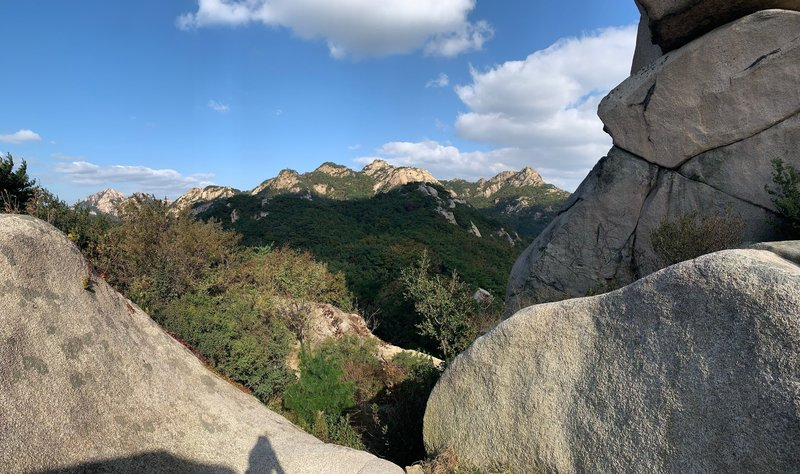 View of ridge traverse route from BiBong. You'll be working your way across the valley to the right side peak, then traversing left to the high peak in the far left frame.