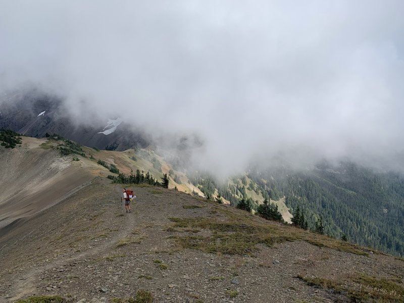 Heading down the ridge from Constance Pass through the clouds.