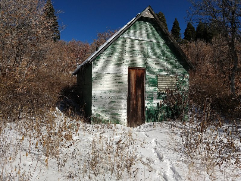 Well-stocked cabin along trail at mid-mountain