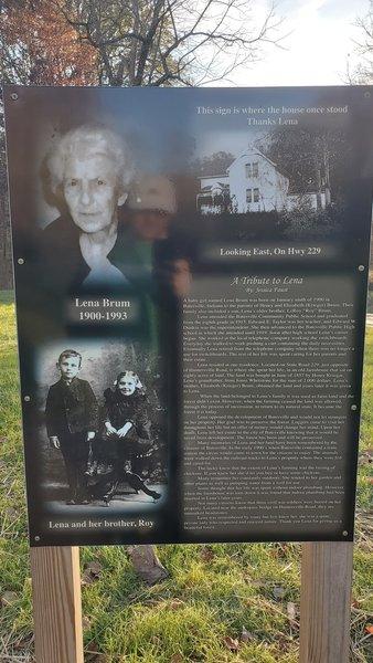 Sign explaining history of Brum Woods.