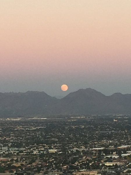 Moon coming up after watching the sunset in the other direction.