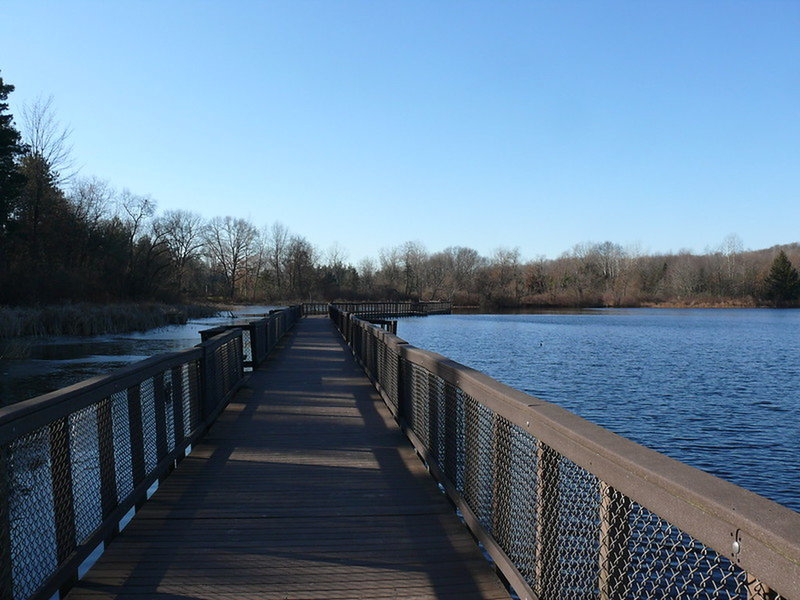 """Pickerel Lake Walkway"""" by John Winkelman (https://tinyurl.com/v95vdys), Flickr licensed under CC BY 2.0 (https://creativecommons.org/licenses/by/2.0/)"""