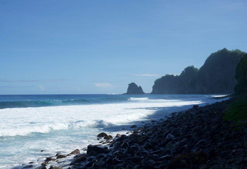 Views of Pola Island from the rocky beach.