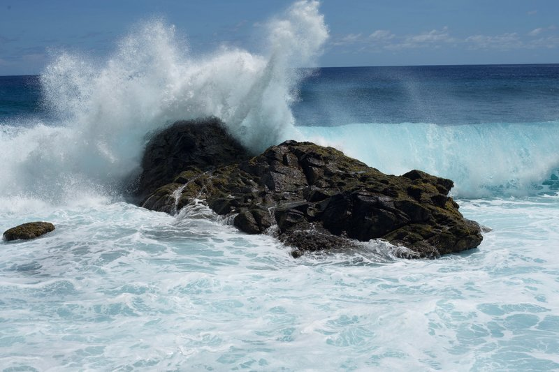 Waves crash into the shoreline on the beach at the end of the Pola Island Trail.