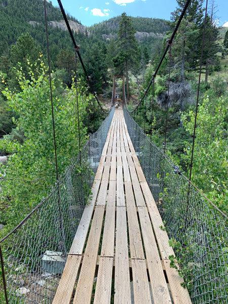 Suspension bridge crossing the Popo Agie at the trailhead