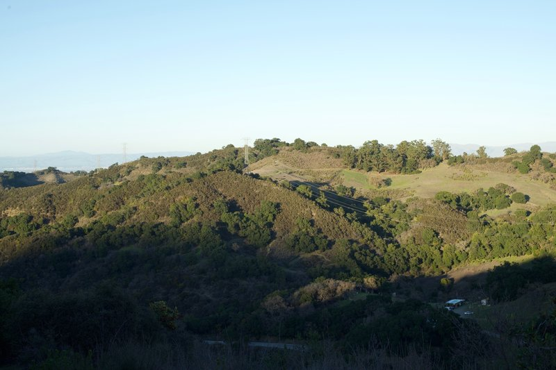 Close to the top of the trail, you can look across the canyon and see Fremont Older Open Space Preserve and the trails that run along the ridge line.