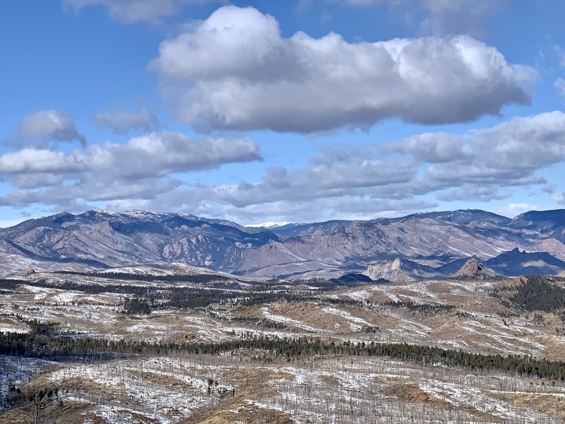 View looking NW from the summit of Signal Butte. Lost Creek Wilderness and a sliver of McCurdy Mountain (snow capped) in the distance.