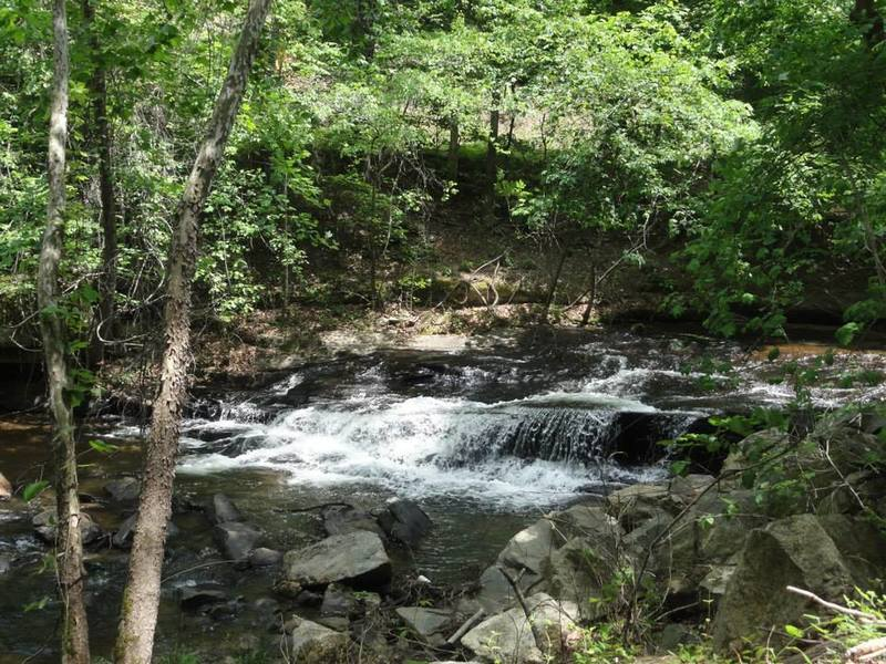 You'll see a small waterfall along the greenway as you hike.