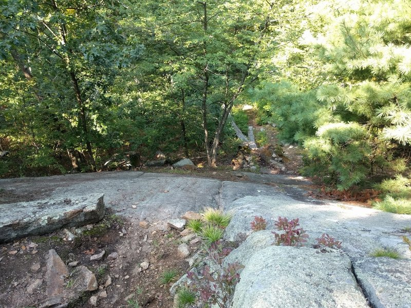 Long, steep rock slab.