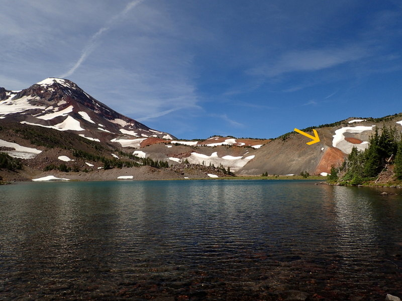 Where the trail (arrow) leaves Camp Lake; South Sister is on the right.