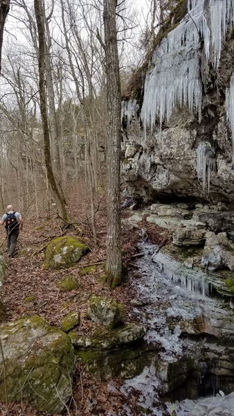 Below the bluff line with icicles on the cliffs.