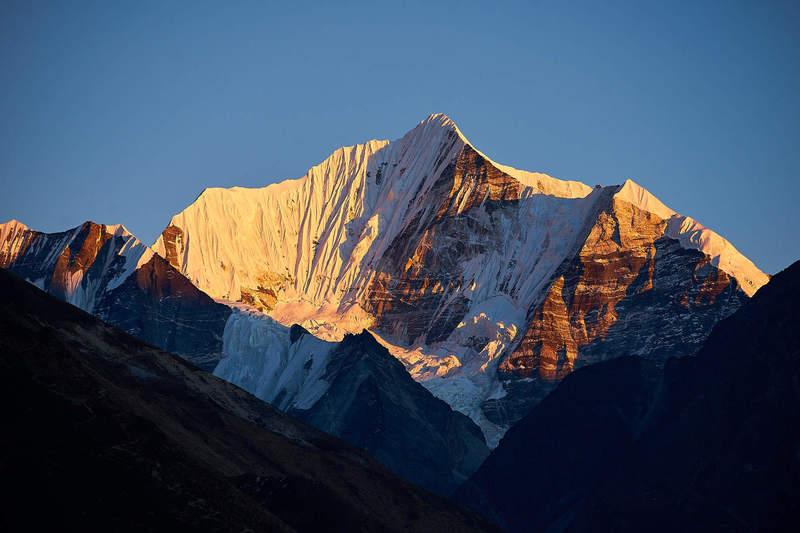 Mount Gangchenpo (6,387 meters / 20,955 feet) as seen from Langtang Village at dusk.