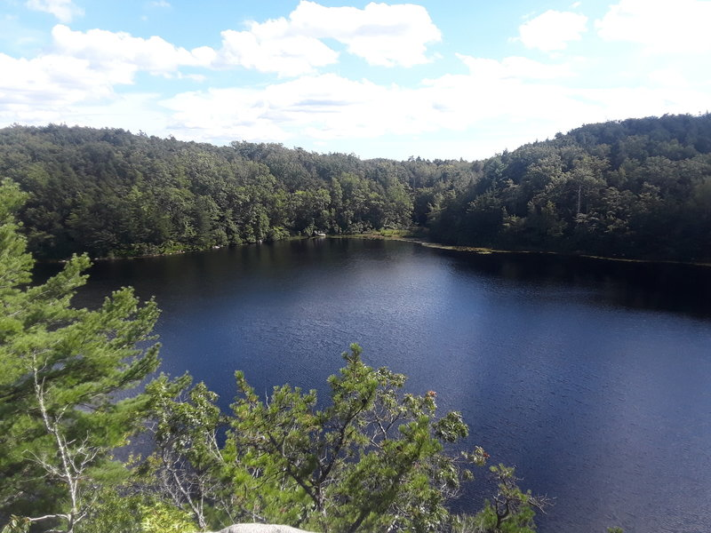 On top of the rock overlooking long pond.