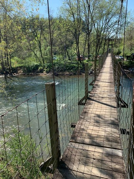 Hike starts and ends using a wobbly bridge over the Maury River.