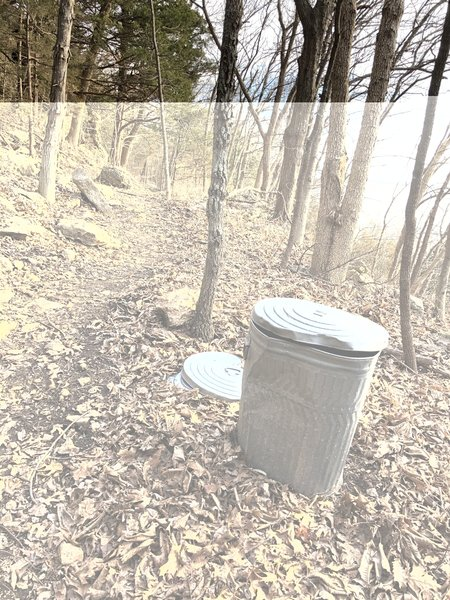 I don't think I've ever run across a trashcan along a trail in the woods...people are definitely using though!  Who dumps this thing?!?  :D