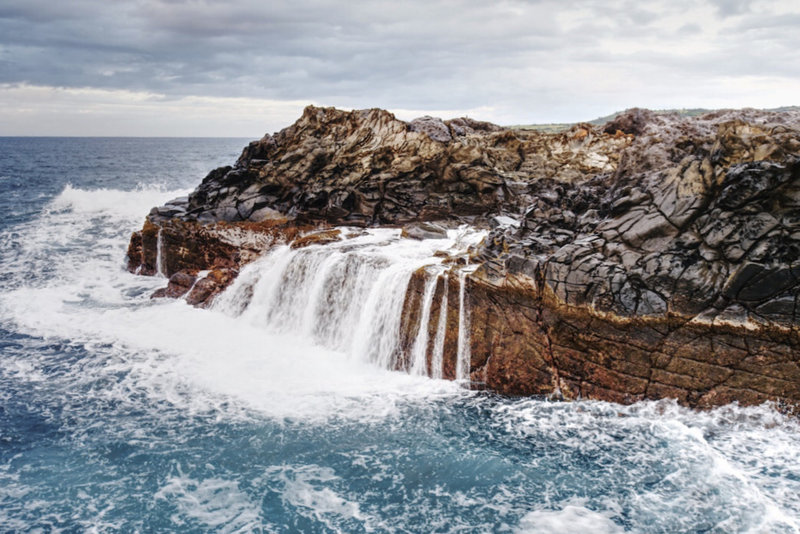 A temporary waterfall after the waves crashed over the rocks at the end of the peninsula.