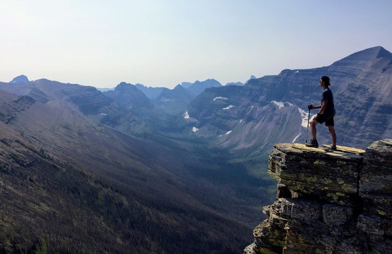 A hiker overlooking the Nyack Creek Valley near Dawson Pass.