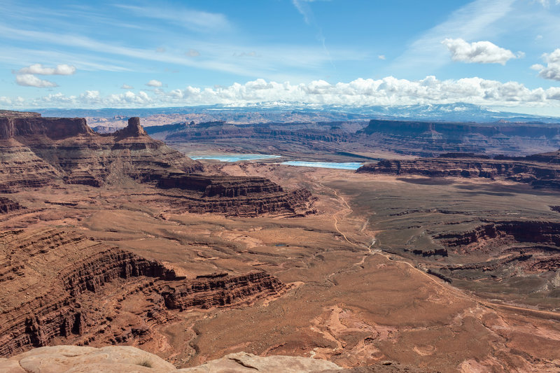 Shafer Basin evaporation ponds and snow covered La Sal Mountains from Dead Horse Point Overlook