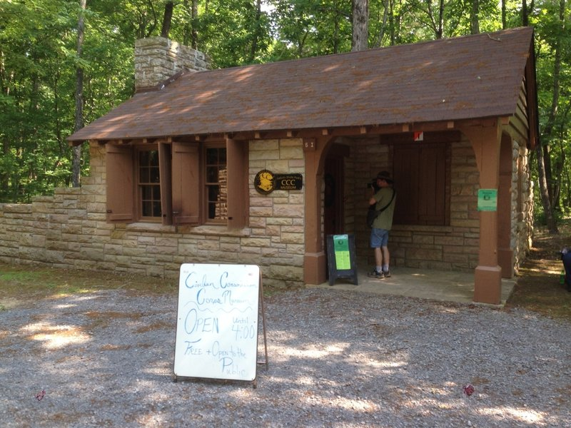 CCC Museum at DeSoto State Park, at entrance road and intersection of Knotty Pine Trail and Dragon's Tail Trail.
