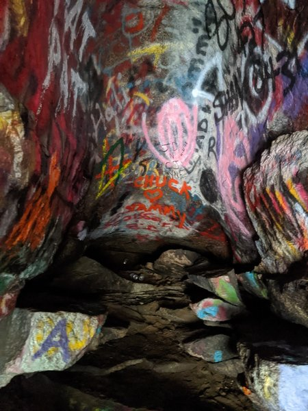 Inside the cave, lots of graffiti