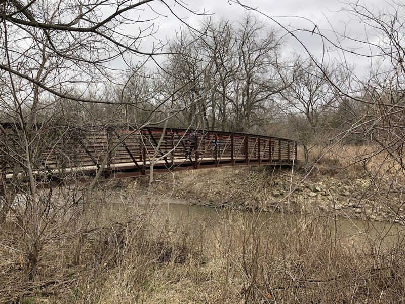 the South-most metal bridge crossing the Cowskin creek in the park