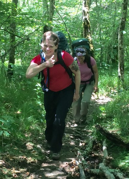 """Hikers give a """"thumbs up"""" for the work of volunteers improving the trail"""