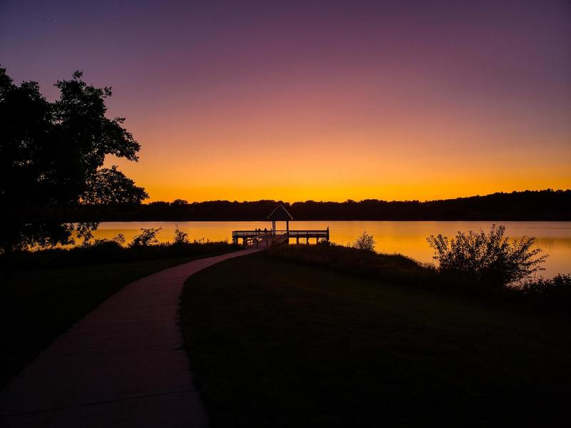 Chalco Hills Recreation Area, Omaha, NE - Fishing dock on cloudless sundown.