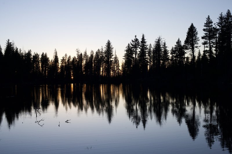While Lassen Peak is definitely the main attraction at sunset, the view to the west is also pretty magical, as the western sky lights up through the trees the line the lake.