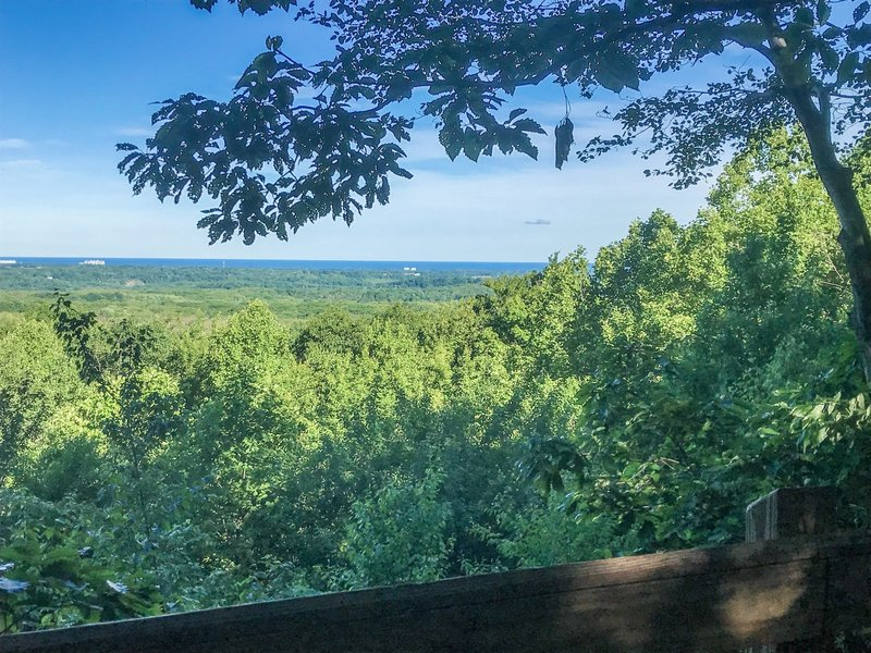Overlook alongside Lucky Stone Loop Trail, with a view of Lake Erie on the horizon.