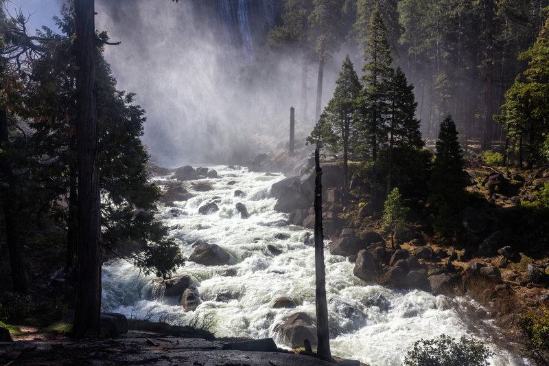 A roaring Merced River at the base of Nevada Falls