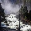 A roaring Merced River at the base of Nevada Falls