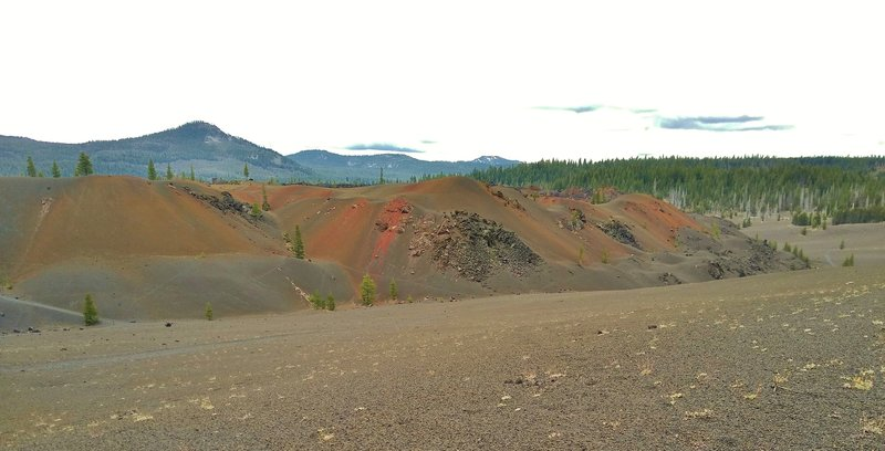 Painted Dunes on the southeast side of Cinder Cone, seen from Nobles Emigrant Trail (East). In the distance to the southeast is Mt. Hoffman, 7,833 ft.