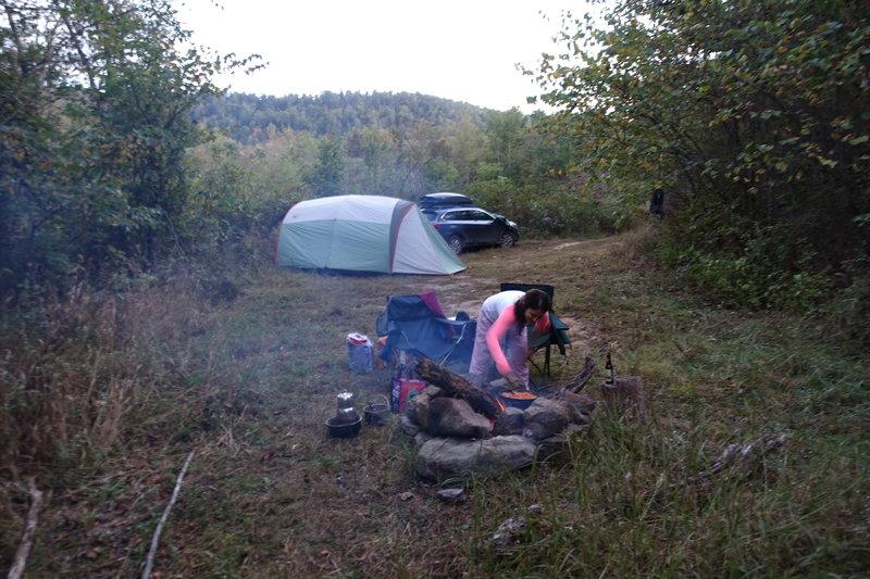 Parking area doubles as a campsite.