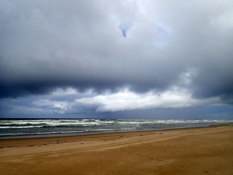 A summer storm approaches the shore
