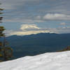 Mount Adams over some lingering snow on the summit