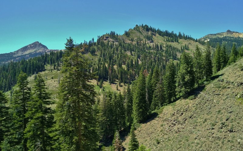 Diamond Peak, 7,968 ft., (center), Brokeoff Mountain, 9,235 ft., (left, distance), and Lassen Peak, 10,457 ft. (right, distance), seen looking northwest from Crumbaugh Trail as it descends steeply to East Sulphur Creek and Mill Creek Falls.