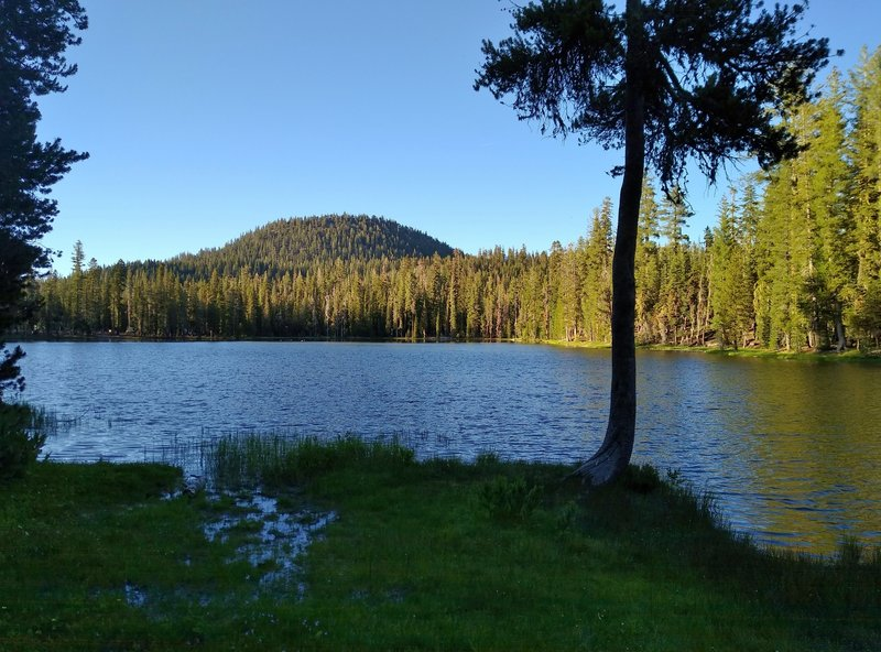 Hat Mountain, 7,695 ft., is seen to the north of Summit Lake from the lake's south shore on a clear summer evening.