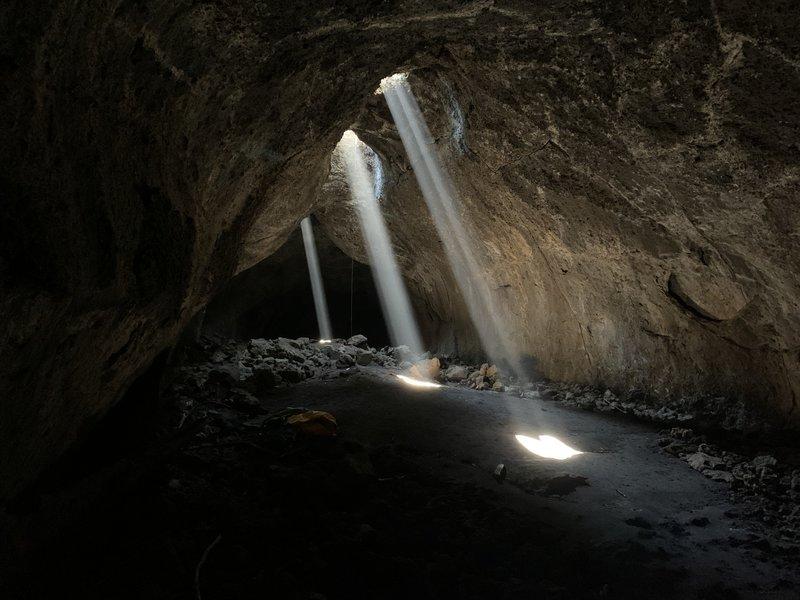 The three stunning sunbeams in Sky Light Cave.