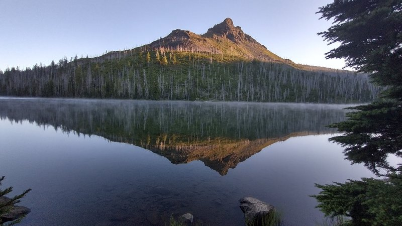 Duffy Butte reflected in the lake.