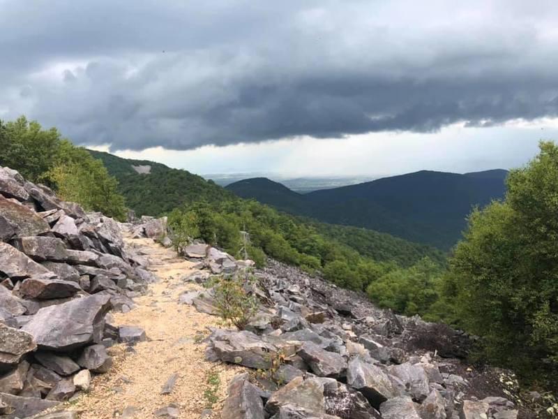 Trail curving around talus slope at Blackrock Mountain summit area.