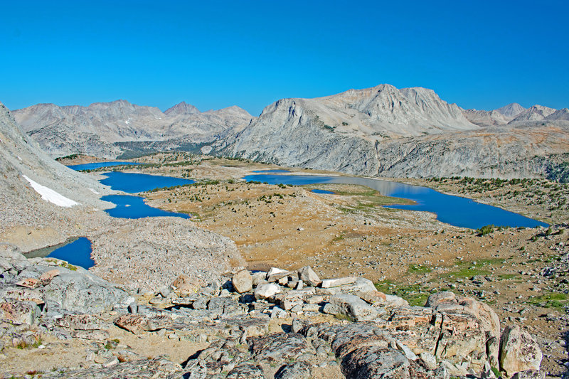 From Puppet Pass. From the left bottom we see Blanc Lake, Lorraine Lake, Paris Lake and Alsace Lake. Puppet Lake and Paris Lake are on the right. Royce Lakes Basin is in the upper right.