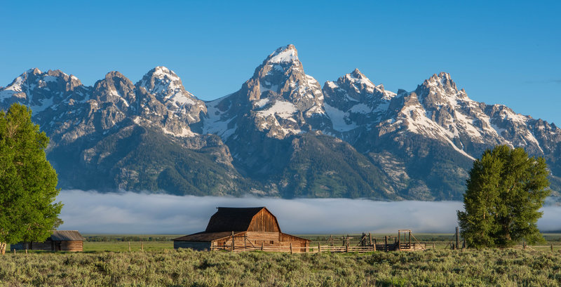 Moulton Barn on Mormon Row with the Grand Tetons, and an early morning fog.