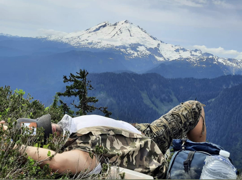 Power nap just off Shannon Ridge trail, with view of Mt. Baker.