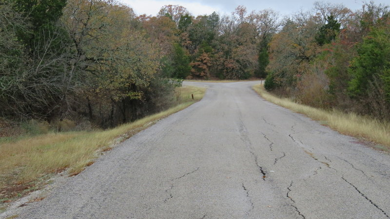 Coming to the Fork in the Road - Next you go left at the split to find the trailhead .