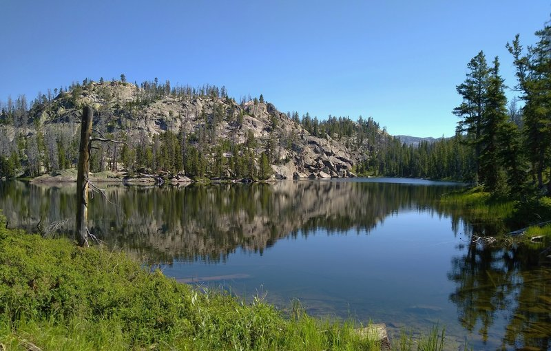 Tiny Lake Vera. Boulder Canyon Trail ends here at a trail junction with Highline Trail.