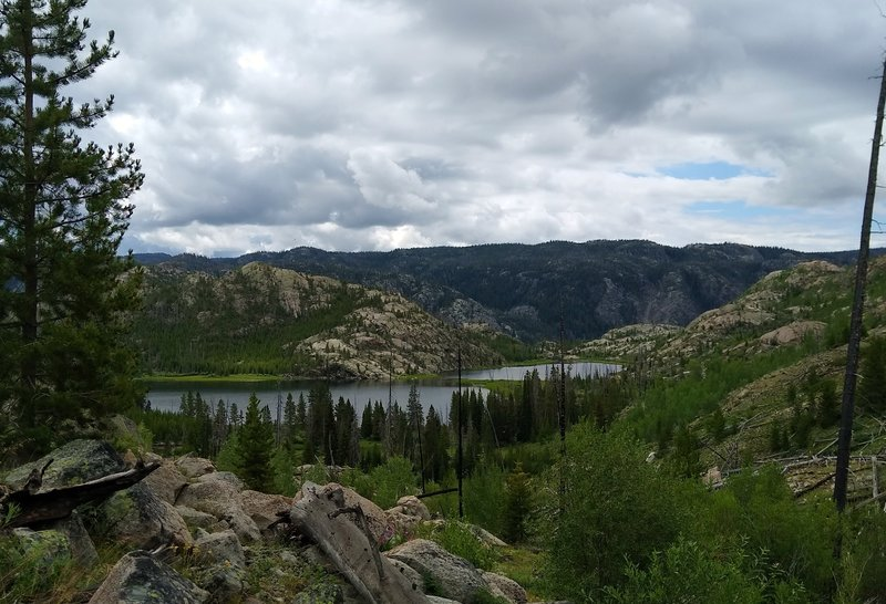 Lake Ethel is set in a rocky basin, as seen from the north on Lake Ethel Trail.