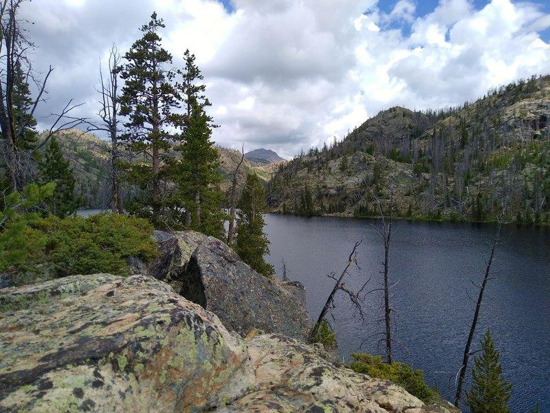Passing Lake Christina in its rocky basin, on Lake Ethel Trail.
