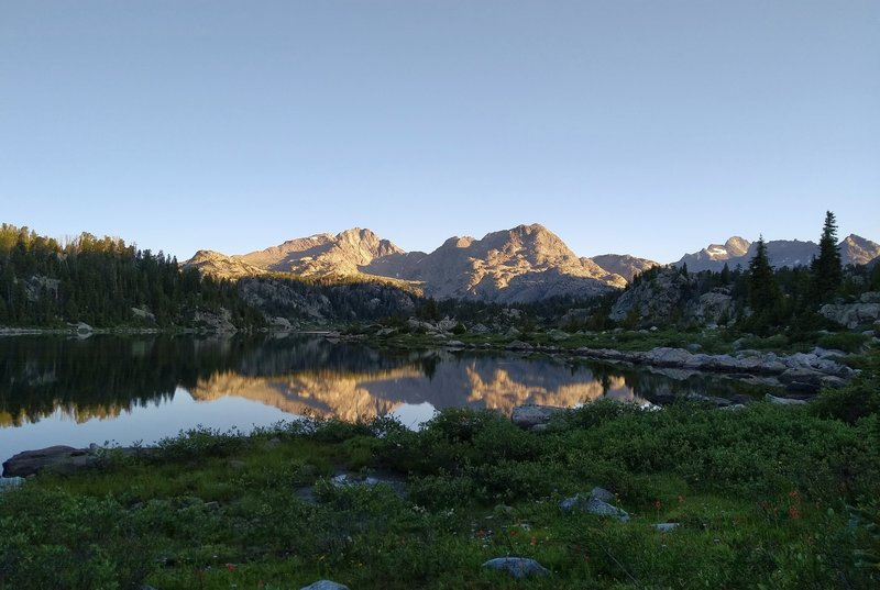 Mt. Lester's two peaks are reflected perfectly at sunrise, in the first Cook Lake.