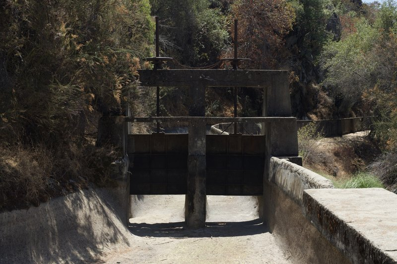 Old sluice gates sit at the end of the trail.