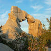 Arch Rock in the morning light. The opening is about 30 feet tall and the entire formation may be 40 - 50 feet tall.